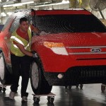 Workers push a Ford Explorer made of Legos in Chicago